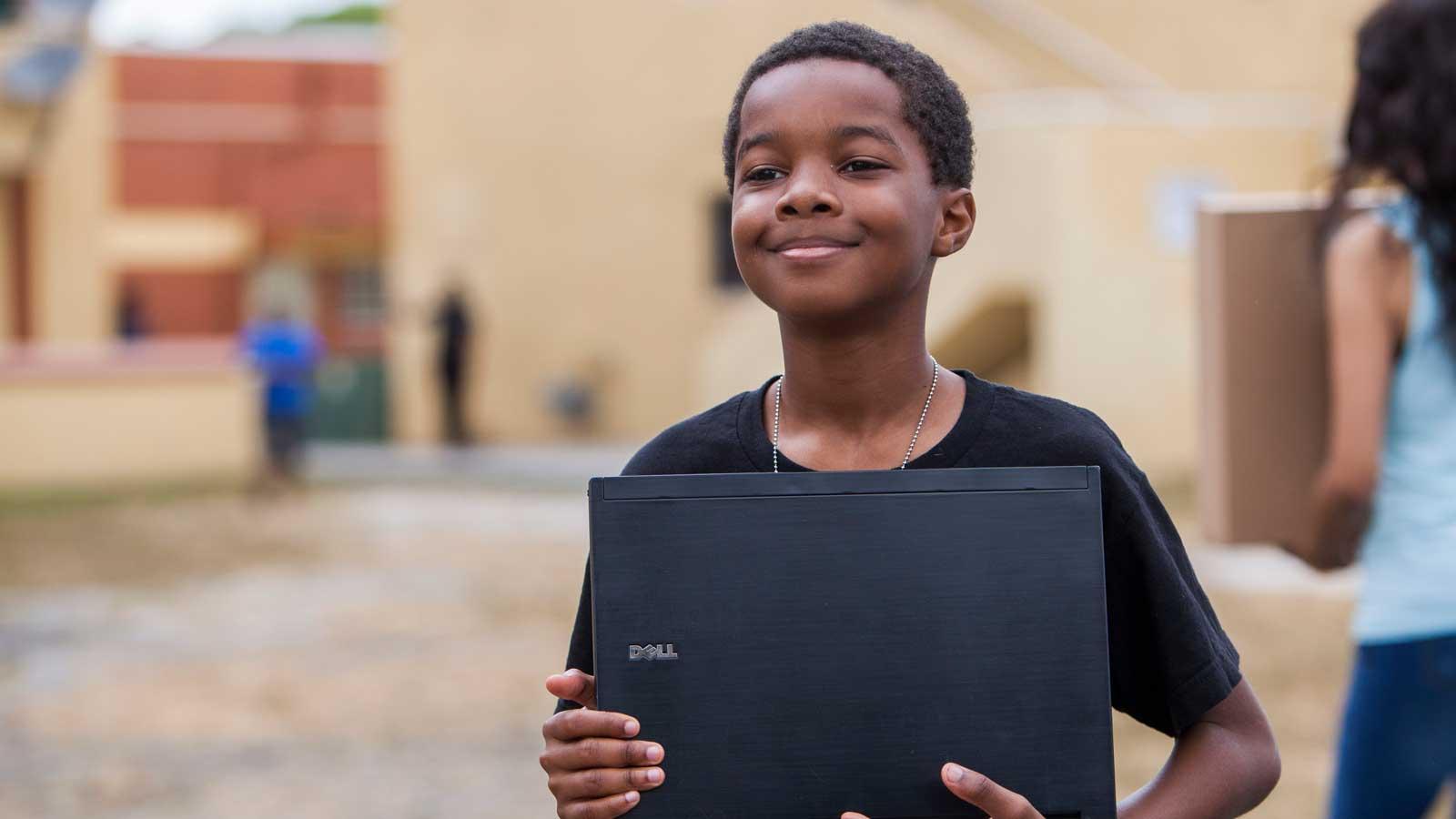 Boy holding laptop