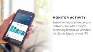 A mobile phone displays the Xfinity xFi app.